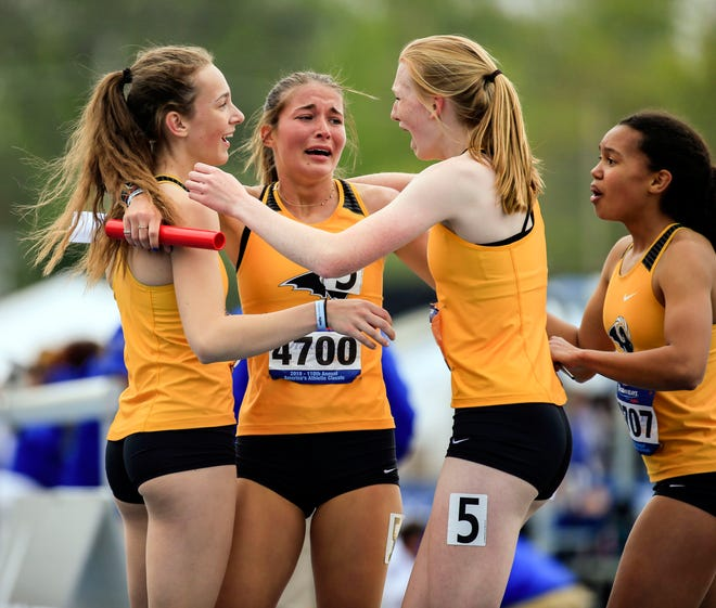 Southeast Polk celebrates after anchoring the winning 4x800 meter relay at the Drake Relays Friday, April 26, 2019.