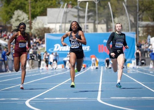 Waterloo East senior Kerris Roberts wins the girls 100-meter dash during Drake Relays at Drake Stadium in Des Moines on Friday, April 26, 2019.