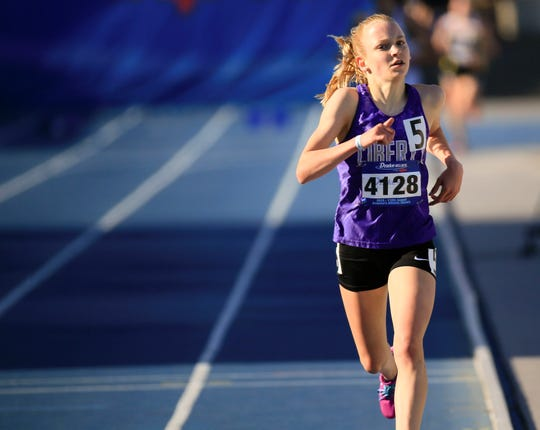 Iowa City Liberty Freshman Ashlyn Keeney wins the girls 3000 meter at the Drake Relays Thursday, April 25, 2019.