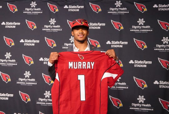 Arizona Cardinals quarterback Kyler Murray holds his jersey at the Cardinals training facility, a day after being drafted with the first overall pick in the 2019 NFL draft, April 26, 2019 in Tempe, Ariz.