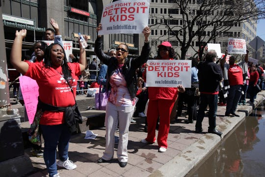 After declaring a school district wide sick-out for the second day, the Detroit Federation of Teachers take to the streets in front of the Fisher Building in Detroit Tuesday May 3, 2016 to protest the threat to their pay.  Mandi Wright/Detroit Free Press