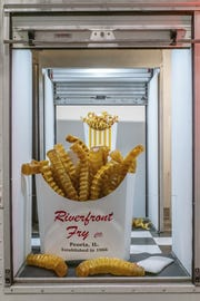 Chicago artist John Miller creates glass hamburgers, fries and doughnuts.