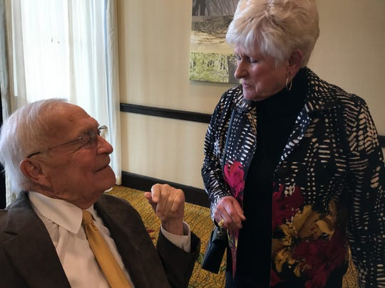 Oakland County Executive L. Brooks Patterson is greeted by his former deputy executive Jean Chamberlain of Royal Oak at the annual Oakland County Economic Outlook luncheon in Troy on April 26, 2019.