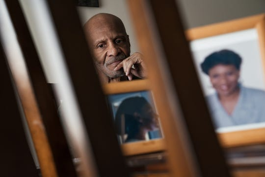 Brent Jones sits with photos of his wife, Gerri Jones, who has has Alzheimer's disease, at his home in Novi on Wednesday, April 24, 2019.