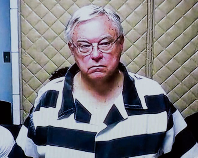 FILE - In this Feb. 26, 2018, file photo, Roman Catholic priest Robert Deland is arraigned via video on various criminal sexual conduct charges from the Saginaw County Jail.