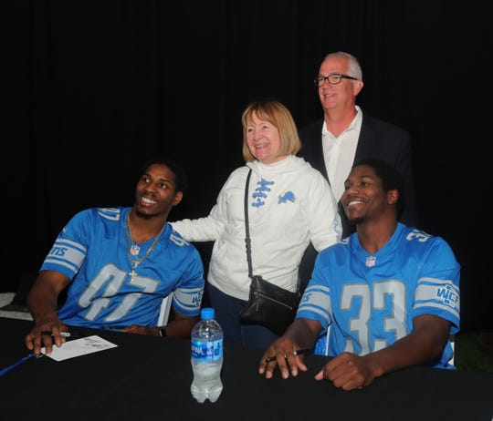 Tara and Hanson Bratton pose with the Detroit Lions' Tracy Walker, left, and Kerryon Johnson during the draft party Thursday, April 25, 2019 at the practice facility in Allen Park.