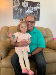 Former Wayne County Executive Robert Ficano with his grandaughter Daphne Ficano, who was just diagnosed with Rett Syndrome, a rare genetic disorder.