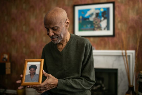 Brent Jones sits with a photo of his wife Gerri Jones, who has has Alzheimer's disease, at his home in Novi on Wednesday, April 24, 2019.