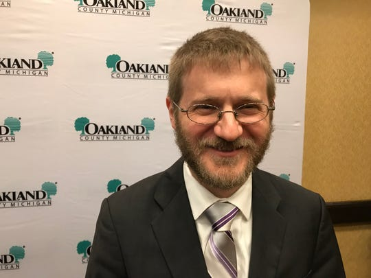 Gabe Ehrlich, University of Michigan economic forecaster, smiles after summarizing the 2019 Oakland County Economic Forecast for reporters, just before announcing findings at the annual luncheon on April 26, 2019 in Troy.