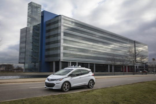 General Motors reorganized to create resources for the development of self-driving cars like this Chevrolet Bolt being tested in Warren, Mich.