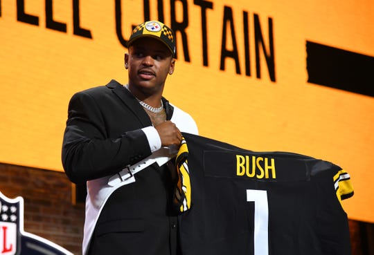 Devin Bush is selected as the 10th overall pick at the draft in downtown Nashville, Tenn.
