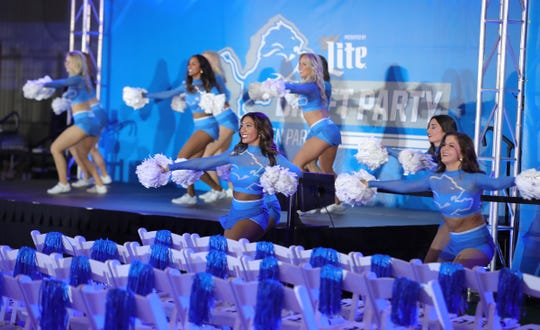 Detroit Lions cheerleaders perform for fans during the draft party Thursday, April 25, 2019 at the practice facility in Allen Park.