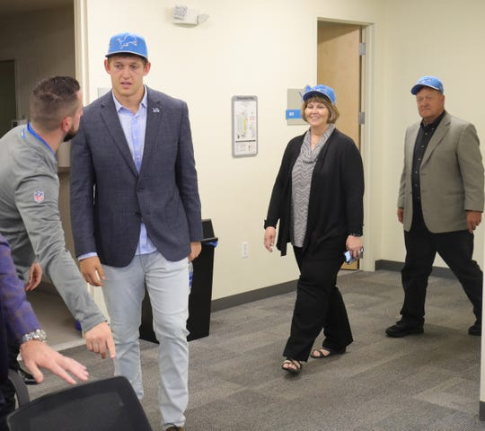 T.J. Hockenson, his mom, Teri, and father, Tod, arrive for an introductory news conference Friday in Allen Park.