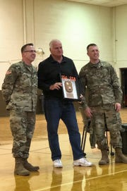 Former Detroit Lions quarterback Eric Hipple, center, has been recognized for his work with veterans in elevating awareness and treatment of traumatic brain injuries.