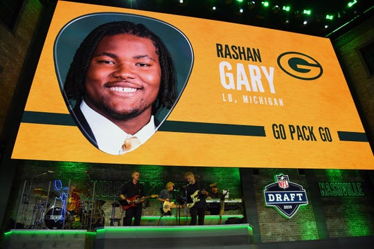Graphic of Rashan Gary on the stage at the NFL draft, after Packers selected him.