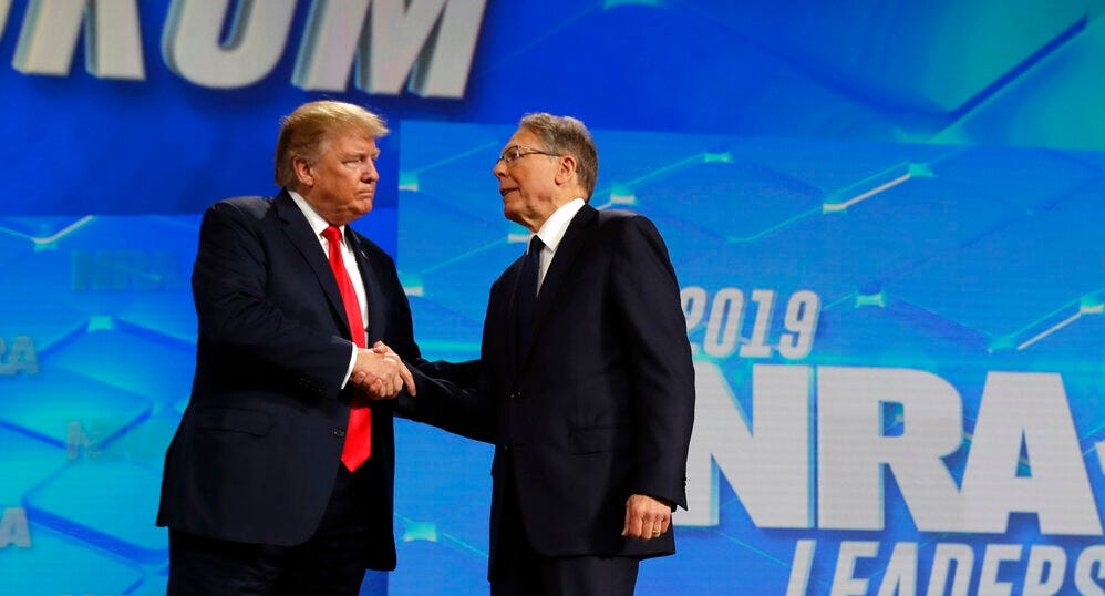 President Donald Trump shakes hands with NRA executive vice president and CEO Wayne LaPierre, has he arrives to speak to the annual meeting of the National Rifle Association, Friday, April 26, 2019, in Indianapolis.
