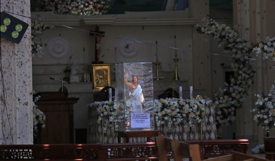 In this Thursday, April 25, 2019 photo, a statue of Jesus Christ stands on the altar of St. Sebastian's Church in Negombo, north of Colombo, Sri Lanka.