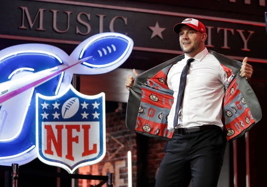 Ohio State defensive end Nick Bosa walks the stage after the San Francisco 49ers selected Bosa in the first round.