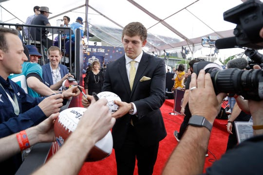 Iowa tight end T.J. Hockenson walks the red carpet before the draft Thursday night.