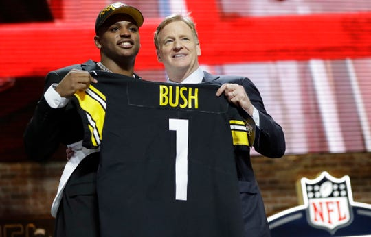 Michigan linebacker Devin Bush poses with NFL Commissioner Roger Goodell after the Pittsburgh Steelers selected Bush in the first round.