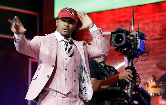 Oklahoma quarterback Kyler Murray waves after the Cardinals selected him with the No. 1 overall pick.