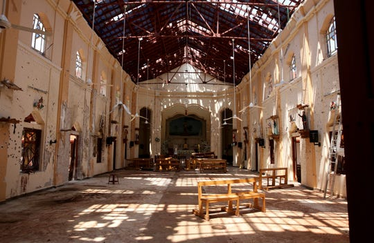 In this Thursday, April 25, 2019 photo, sunlight steams in from gaping holes at St. Sebastian's Church in Negombo, north of Colombo, Sri Lanka.