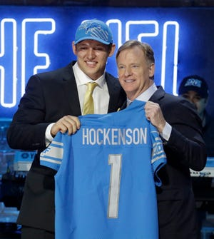 Iowa tight end T.J. Hockenson poses with NFL Commissioner Roger Goodell after being selected by the Lions.