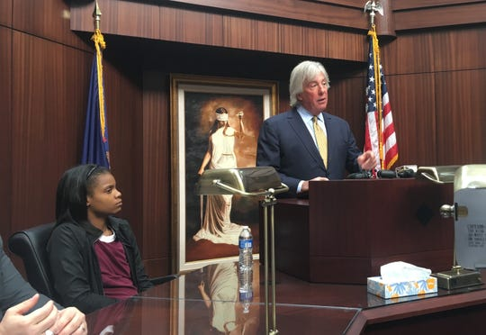 Attorney Geoffrey Fieger (right) addresses the media as his client, Ariel Moore, who is suing the Detroit police department for officers' alleged roles during a January traffic stop, looks on