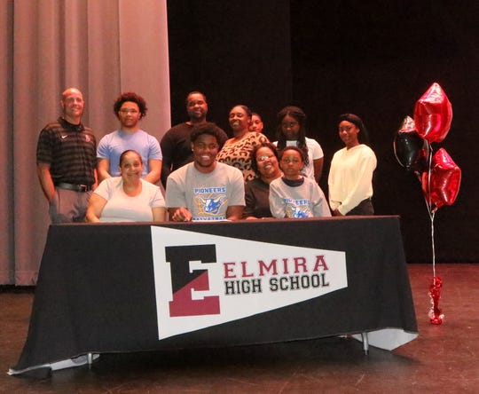 Markel Jenkins signs to play basketball at Alfred State during a ceremony at Elmira High School on April 25, 2019.