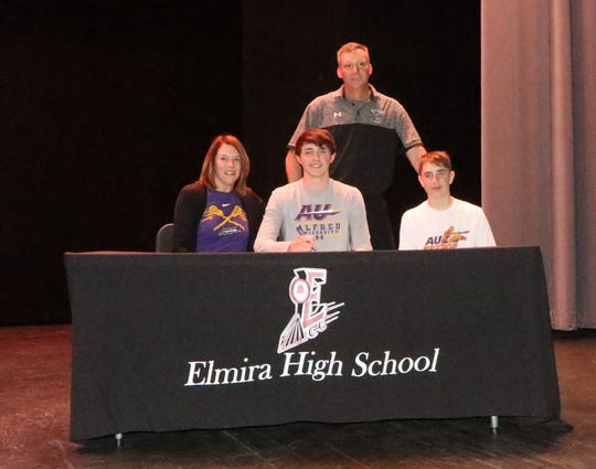 Drew Cartwright signs to play lacrosse at Alfred University during a ceremony at Elmira High School on April 25, 2019.