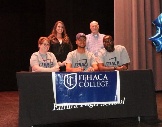 Theo Summerville signs to dive at Ithaca College during a ceremony at Elmira High School on April 25, 2019.
