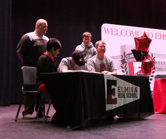 Elmira senior Ryan Stowell signs to play baseball at Mansfield University during a ceremony at Elmira High School on April 25, 2019.