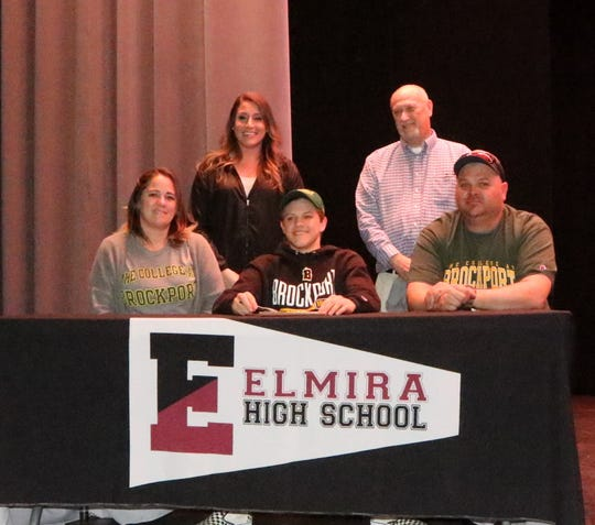 Randy Beach signs to dive at SUNY Brockport during a ceremony at Elmira High School on April 25, 2019.