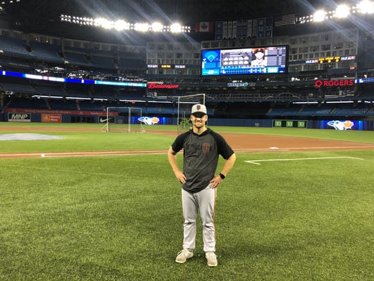 Brant Whiting was the Evansville Otters' catcher last summer. Now he's the San Francisco Giants' bullpen catcher. Pictured at Rogers Centre in Toronto.