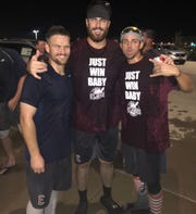 Brant Whiting (left) celebrates after the Otters clinched a playoff berth last summer.