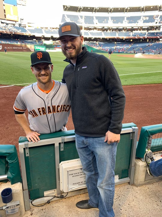 Brant Whiting stands with Otters pitcher Austin Nicely in Washington D.C. They were teammates, and Nicely is back on the Otters this year.