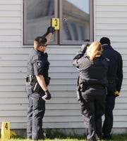 Fond du Lac police investigate bullet holes fired into a house Friday, April 26, 2019 along Morris Street. Doug Raflik/USA TODAY NETWORK-Wisconsin