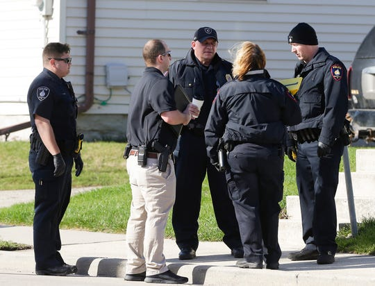 Fond du Lac police detectives investigate bullet holes fired into a house Friday, April 26, 2019 along Morris Street in the City of Fond du Lac, Wis. Doug Raflik/USA TODAY NETWORK-Wisconsin
