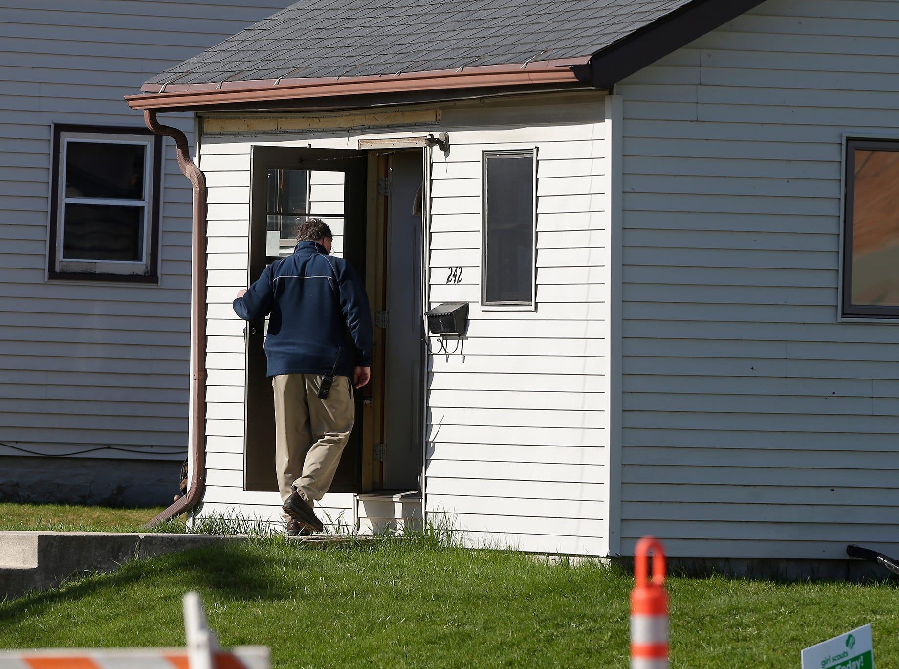 The City of Fond du Lac Police Department investigates possible bullet holes in a house Friday, April 26, 2019 at 242 Morris Street in the City of Fond du Lac, Wis. Doug Raflik/USA TODAY NETWORK-Wisconsin
