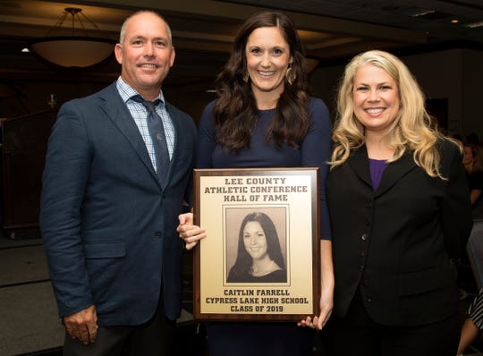 Caitlin Farrell, a 2006 Cypress Lake High School graduate, is inducted into the Lee County Athletic Conference Hall of Fame on Thursday in Fort Myers. Farrell played soccer at Cypress Lake. Farrell's brother, Liam, left, and Cypress Lake principal Angela Roles are among her supporters.