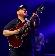 Country musician Luke Combs performs for a sold-out crowd of about 8,000 on Thursday night at the Resch Center for a stop on his Beer Never Broke My Heart Tour.
