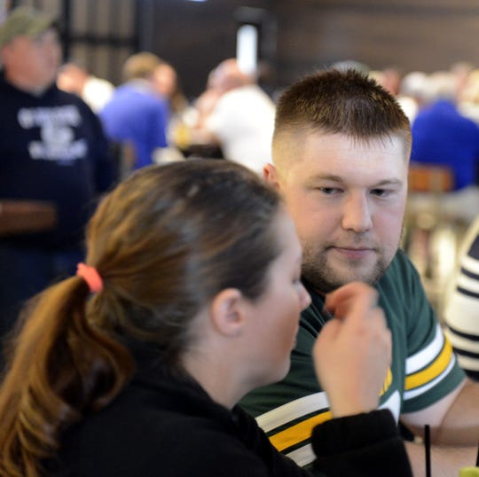Jennifer and Justin Virkus of Haugen talk at 1919 Kitchen & Tap at Lambeau Field Thursday, April 25, 2019, while waiting for the Green Bay Packers to draft their first player.