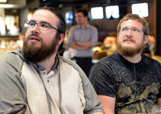 Ryan Northway, left, of Oneida and Ryan Peters of Green Bay keep track of the NFL draft Thursday, April 25, 2019, at 1919 Kitchen & Tap at Lambeau Field in Green Bay, Wis.