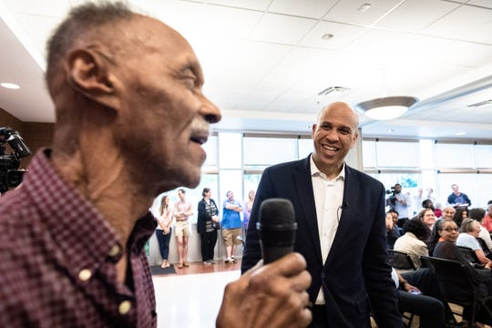 Carl Fowler, 71, of Spartanburg, asks Cory Booker, U.S senator from New Jersey, and a 2020 democratic presidential candidate a question at his rally at the C.C Woodson Community Center in Spartanburg during his visit to the city Thursday, Apr. 25, 2019.