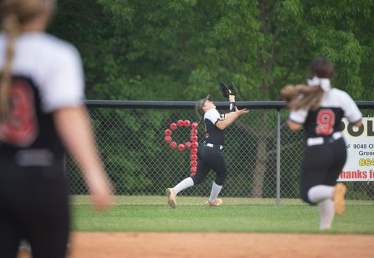Blue Ridge's Ashley Styles (11) catches a fly ball during the game against Pickens High School at Blue Ridge Thursday, April 25, 2019.