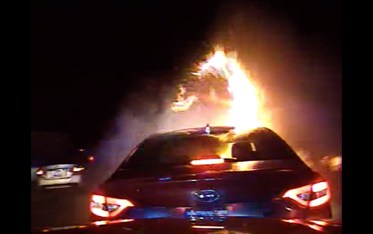 """A screenshot from the dashcam video of a S.C Highway Patrol officer which shows the vehicle of Imhotep """"O'Sha"""" Norman engulfed in flames after he fled in Greenville County, coming to a stop on interstate 85 in Spartanburg County Friday, Apr. 12, 2019. Norman ran from the vehicle leaving his 1-year-old daughter Xena Norman inside to die in the vehicle fire."""