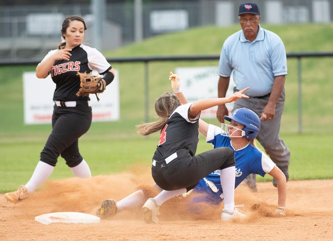 Pickens' Sami Turner (4) is tagged out by Blue Ridge's Jessica Owens (4) during the opening round of the softball playoffs Thursday night at Blue Ridge.