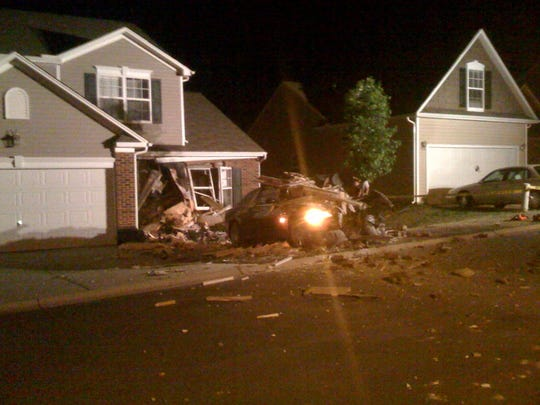 This archive photo from 2009 shows the scene at 18 War Admiral Way in Greenville just outside of Travelers Rest, where John Ludwig's Maserati plowed through a home, killing Frederic William Bardsley, 62.