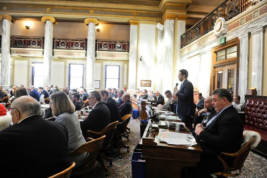 Rep. Daniel Zolnikov, R-Billings, speaks on the House Floor at the State Capitol Thursday, April 25, 2019, in Helena, Mont. (Thom Bridge/Independent Record via AP)