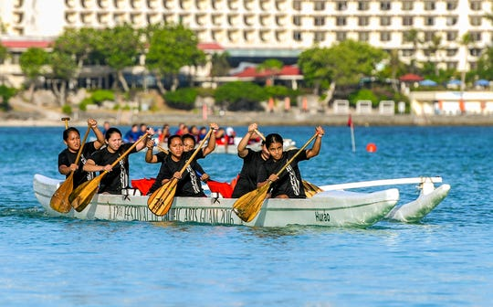 In this file photo from April 2019, high school paddling team compete against each other in a 2000m slalom race during highschool paddling competition in the waters off Matapang Beach at Tumon.
